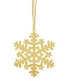 Flocon de neige d'or de Noël sur le ruban d'isolement sur le blanc Photographie stock libre de droits