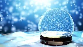 Flocon de neige de globe de neige de Noël avec des chutes de neige sur le fond bleu Image stock