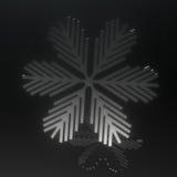 Flocon de neige en verre noir sur le noir Photo stock