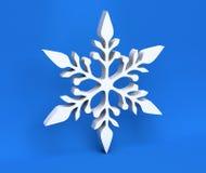 flocon de neige de Noël 3d blanc d'isolement sur le fond bleu Photo stock