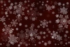 Flocons de neige blancs sur un fond rouge foncé abstrait Photos stock