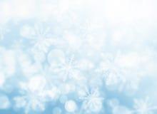 Flocons de neige bleus de bokeh Photo stock
