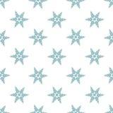Flocons de neige bleus sur un fond blanc Images stock