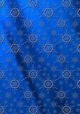 Flocons de neige bleus sur un fond onduleux bleu-foncé de gradient Photos stock