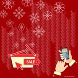 Flocons de neige d'achats de Noël sur les mains rouges utilisant le téléphone intelligent Photographie stock