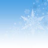 Flocons de neige de Noël sur le fond bleu Photographie stock