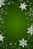 Flocons de neige de vecteur de Noël à un arrière-plan vert Photographie stock libre de droits