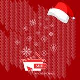 Flocons de neige de vente d'hiver d'achats de Noël sur le panier à provisions rouge Images libres de droits