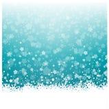 Flocons de neige et fond de Noël d'étoiles Image stock