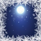 Flocons de neige et lune de Noël sur le fond bleu-foncé Photos stock