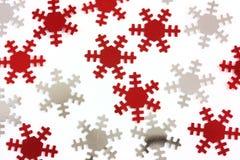 Flocons de neige rouges et argentés Photographie stock libre de droits