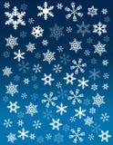 Flocons de neige sur le fond bleu image libre de droits