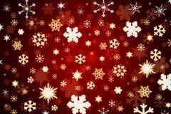Flocons de neige sur le fond rouge Photographie stock