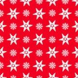 Flocons de neige sur un fond rouge Photographie stock