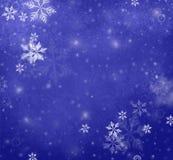 Flocons de neige tombant sur le fond bleu de Noël, fond d'hiver Image stock