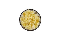 Flocos de milho em uma bacia de vidro tradicional acastanhada com suporte Disparado de cima de Fotografia de Stock Royalty Free