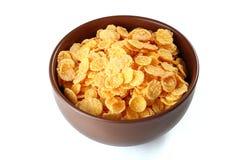 Flocos de milho no fundo branco Imagens de Stock