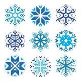 Flocos de neve, ícones azuis do inverno ajustados Imagens de Stock