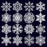 Flocos de neve ajustados Elementos brancos do inverno para o projeto na obscuridade - fundo azul Imagens de Stock