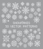 Flocos de neve ajustados Ponto transversal 50 testes padrões do vetor Elementos da decoração do inverno foto de stock
