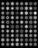 Flocos de neve brancos em um fundo preto Fotografia de Stock Royalty Free