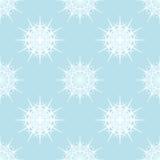 Flocos de neve brancos na luz - fundo azul Fotografia de Stock Royalty Free