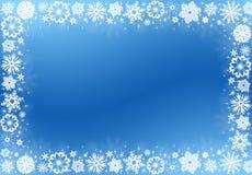 Flocos de neve brancos no azul - frame do Natal Imagem de Stock