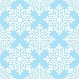 Flocos de neve brancos no teste padrão sem emenda do fundo azul Fotografia de Stock