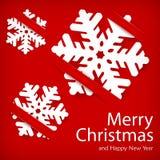Flocos de neve de papel no vermelho Fotografia de Stock