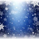 Flocos de neve do Natal no fundo azul Fotos de Stock