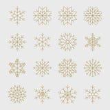 Flocos de neve dourados ajustados ilustração do vetor