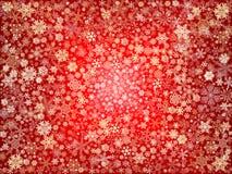 Flocos de neve dourados no vermelho Fotos de Stock