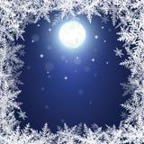 Flocos de neve e lua do Natal na obscuridade - fundo azul Fotos de Stock