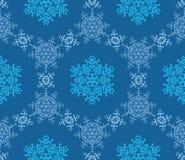 Flocos de neve em um fundo azul Fotografia de Stock Royalty Free