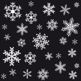 Flocos de neve em um fundo preto. Fotos de Stock Royalty Free