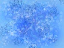 Flocos de neve no azul Imagens de Stock Royalty Free