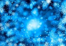 Flocos de neve no azul Imagem de Stock