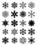 Flocos de neve pretos em um fundo branco Foto de Stock Royalty Free
