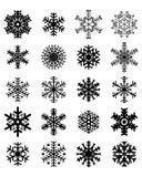 Flocos de neve pretos em um fundo branco Imagem de Stock