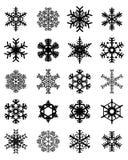 Flocos de neve pretos em um fundo branco Imagens de Stock