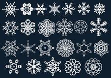 Flocos e estrelas da neve do vetor Foto de Stock