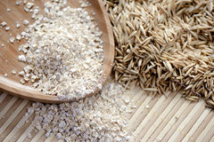 Flocos e sementes da aveia Foto de Stock