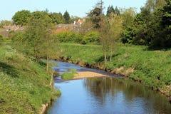 Flod i bygd Arkivbild