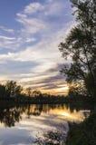 Flod och solnedgång Royaltyfri Fotografi
