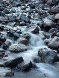 Flod och stenar Fotografering för Bildbyråer