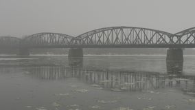Floe floating under the bridge. Grey floe floating throw under the big bridge stock footage