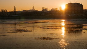 Floe flowing along the Vistula River at sunset stock video