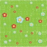 Floers op grasachtergrond Stock Afbeeldingen