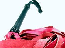 Flogger rosso Fotografia Stock