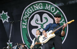 Flogging Molly. Bob Schmidt (left) and Dennis Casey (right) of Flogging Molly during performance on festival Rock for People, July 5, 2012 Royalty Free Stock Photos